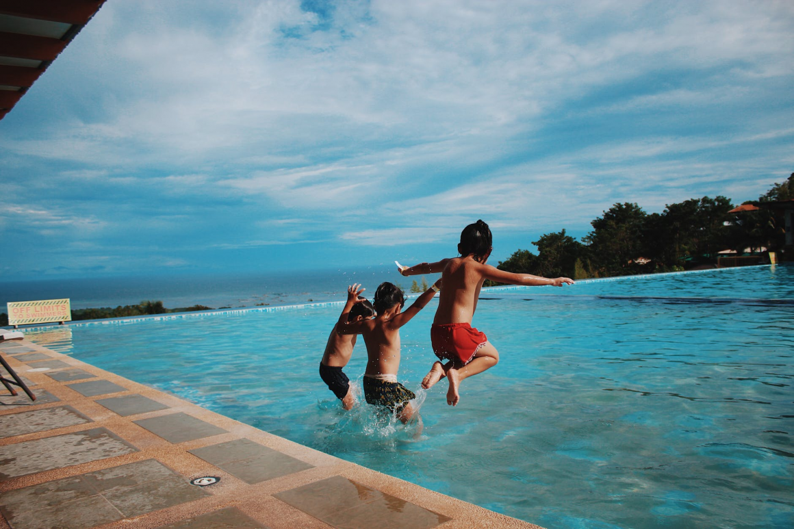 children jump into the pool